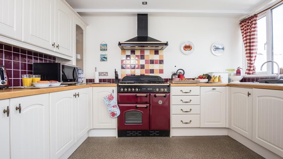 The old fashioned aga adds character to this stylish kitchen interior.