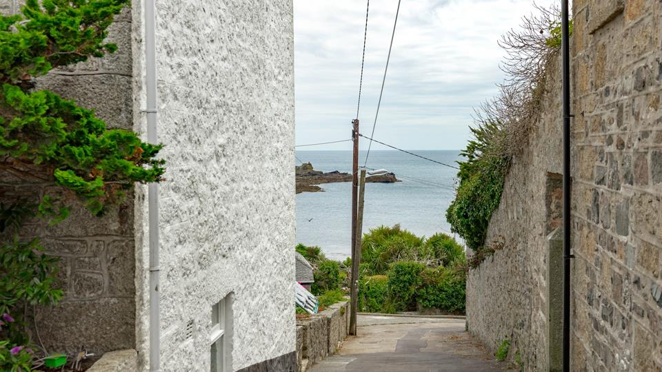 This lane down the side of the property leads to Mousehole harbour.