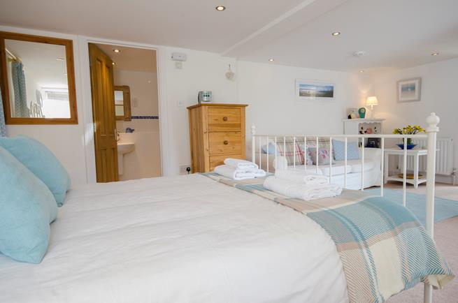 The spacious double bedroom also has a lovely three-seater sofa.