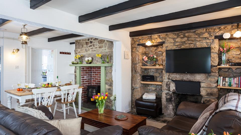 The living space has a granite inglenook fireplace with a second brick back fireplace and electric wood burner effect fire.