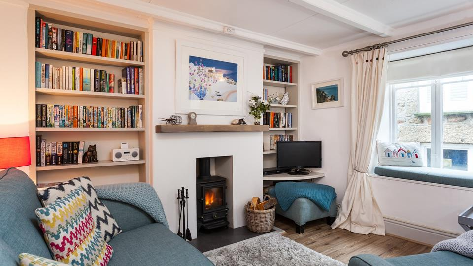 Living room with cosy woodburner