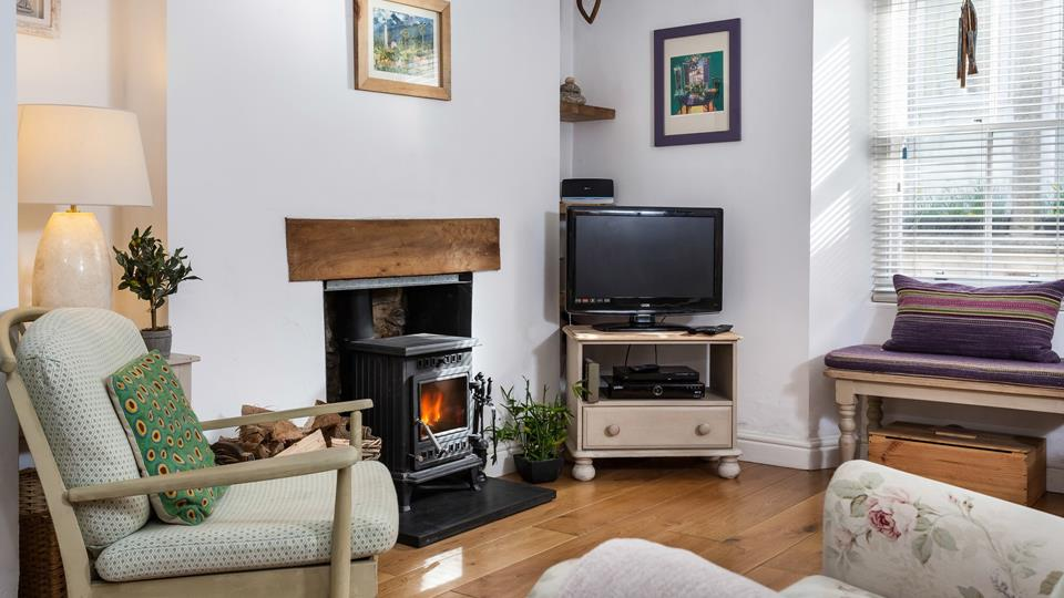 Cosy sitting room, warm your toes  by the woodburner.