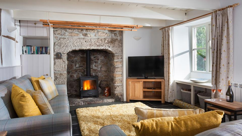 Cosy sitting room with woodburner.