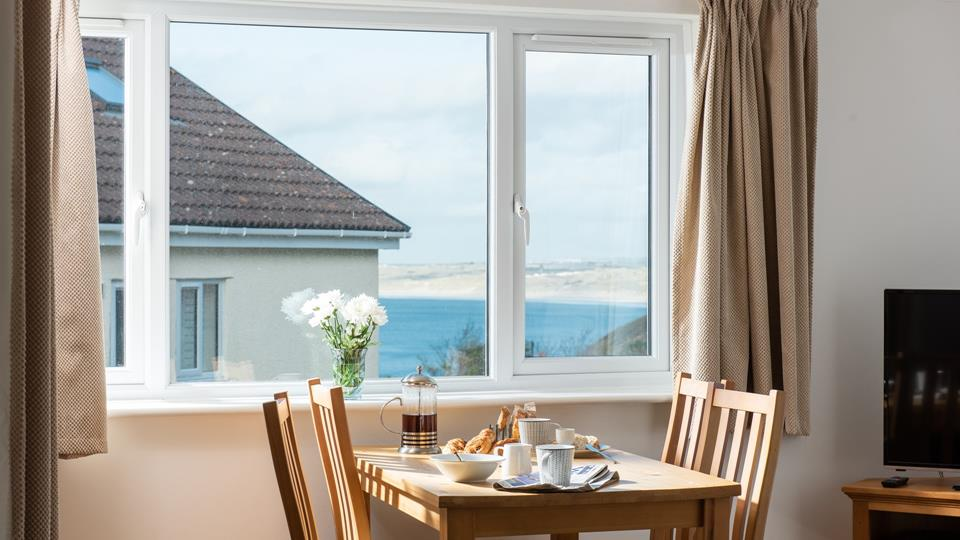 Enjoy breakfast overlooking the stunning view of Carbis Bay from the dining area.