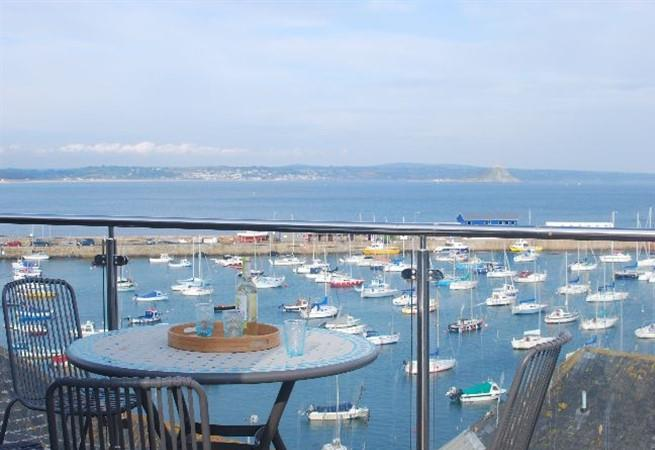 Watch the boats come and go as you enjoy an afternoon drink on the terrace