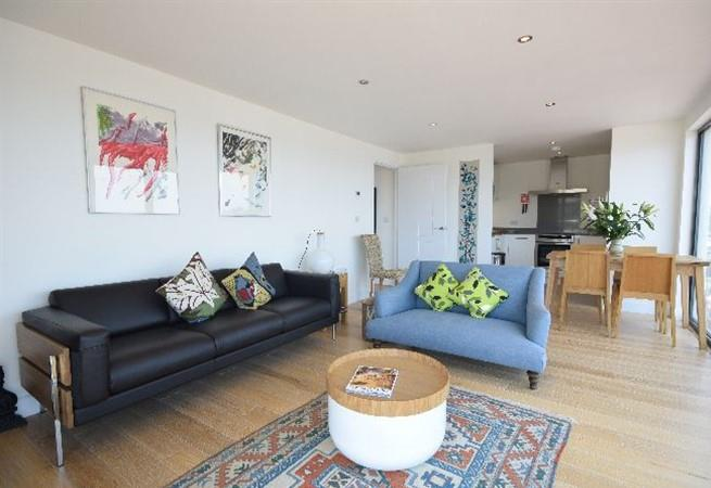 The open plan living space is light and airy