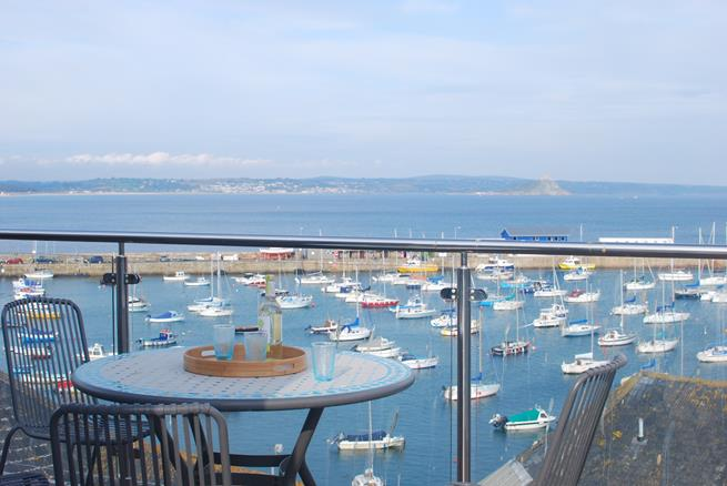 Watch the boats come and go as you enjoy an afternoon drink on the terrace.