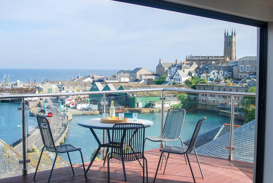 The terrace has breath taking views across the harbour and out towards St Michael's Mount.