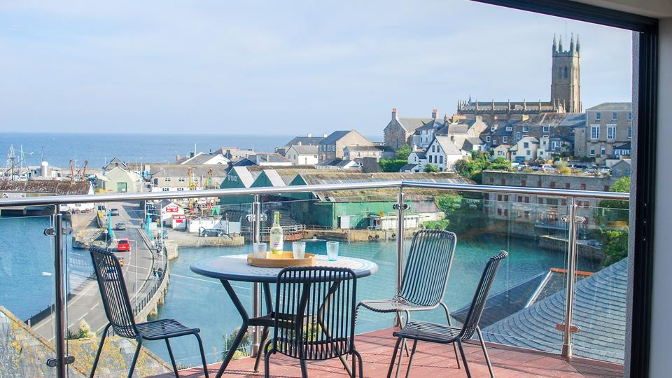 The terrace has breathtaking views across Penzance,  the harbour and across Mounts Bay towards St Michael's Mount.