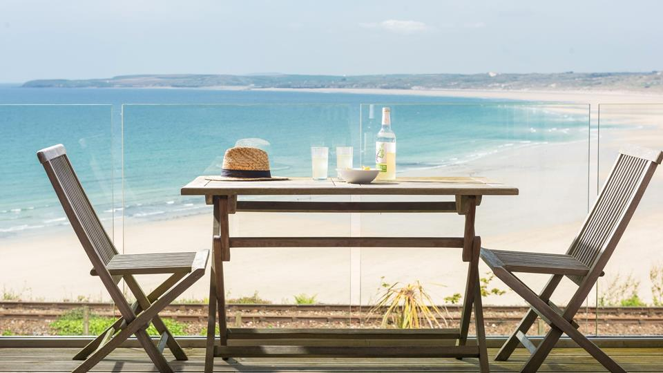 Enjoy uninterrupted views over Porthkidney Beach and beyond on your private and idyllic balcony.
