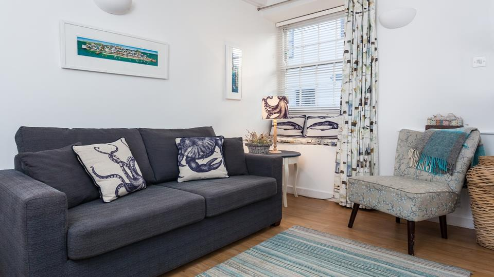 A charming retreat, Bakehouse Cottage seamlessly blends traditional features with modern comfort.