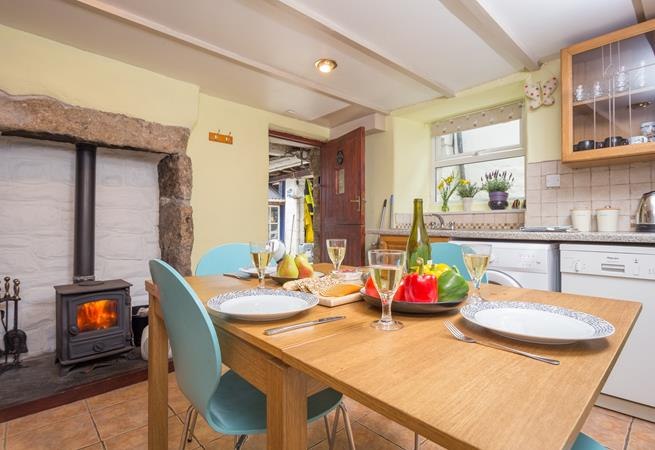 Gather round the table for a delicious meal together, lighting the woodburner on cold days or throwing open the door to the patio on warmer days.