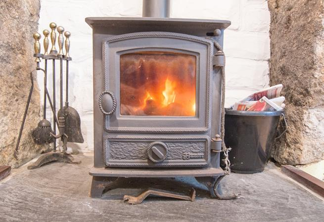 Warm up by the woodburner whilst you play a board game at the table.