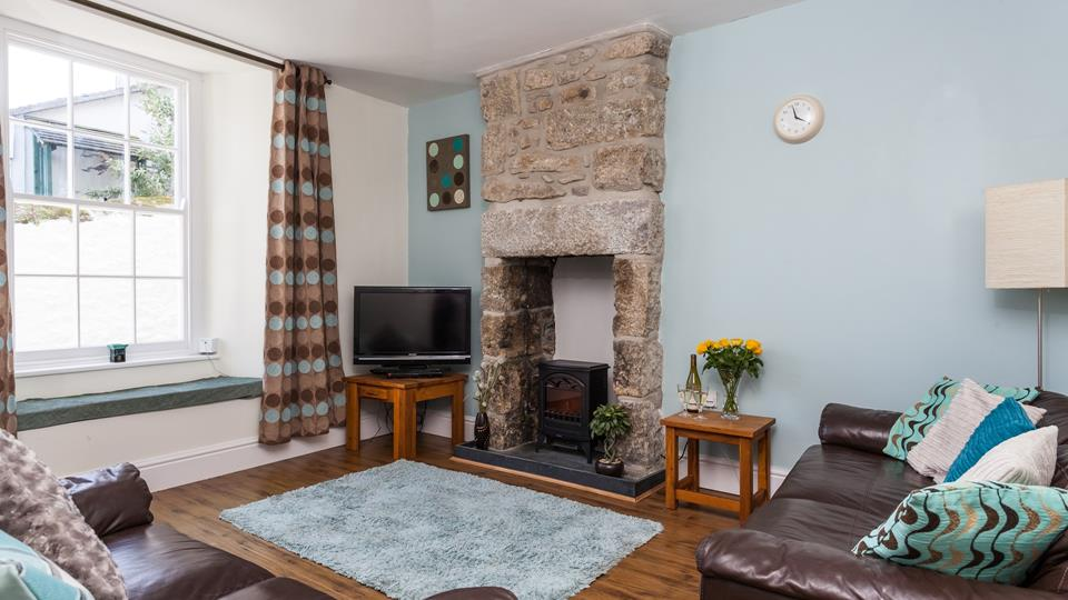 Enjoy cosy evenings curled up next to the wood burner at Vine Cottage.