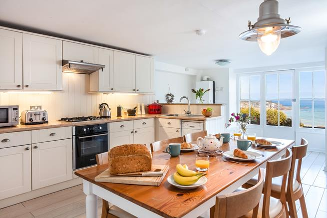 Open plan farmhouse style kitchen and dining room.