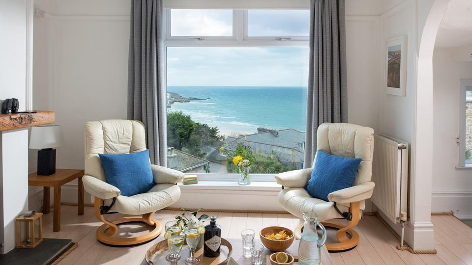 A stunning view over St Ives Bay from the sitting room area, enjoy relaxing in the leather recliner chairs and relax.