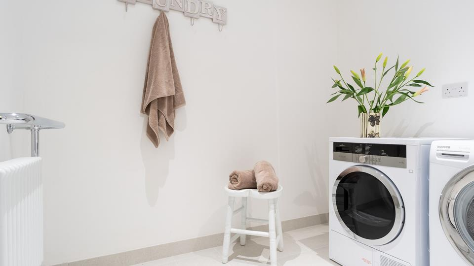 The utility room has a washing machine and dryer which is ideal after a day on the beach.