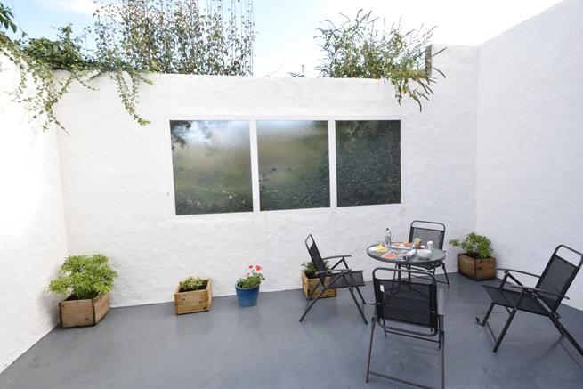 Enclosed terrace at the rear is perfect for afternoon tea.