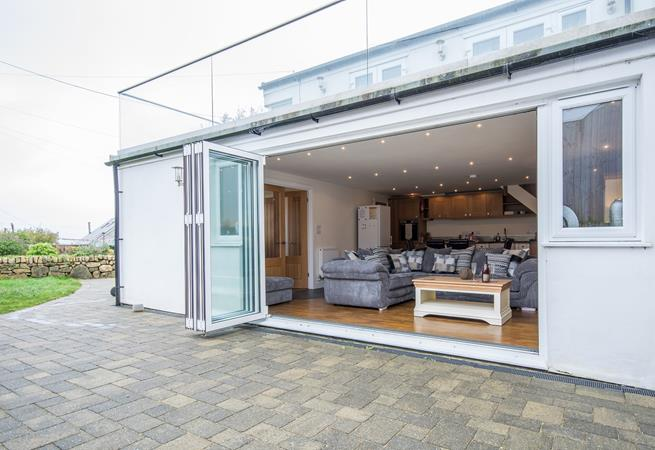 Large bi-fold doors lead to patio and garden.