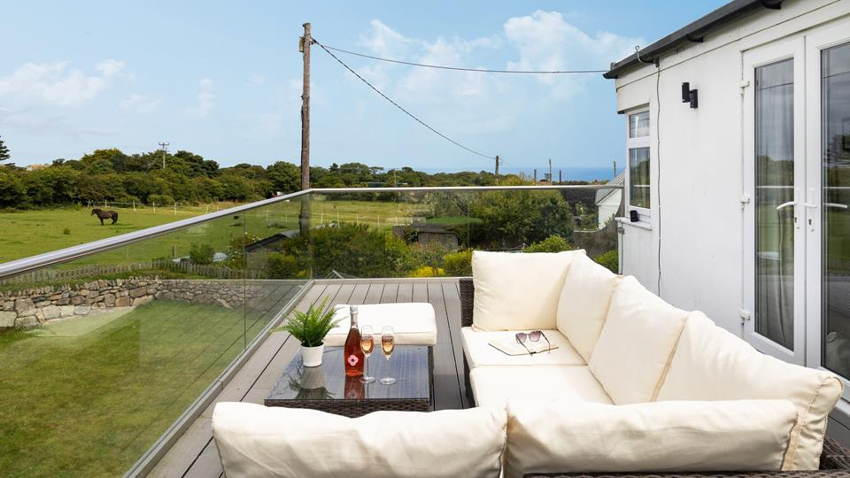 Spend time sharing holiday stories while enjoying the Cornish countryside from your secluded balcony.