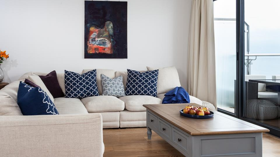 Beautifully furnished with an abundance of soft furnishings, and rich colours.