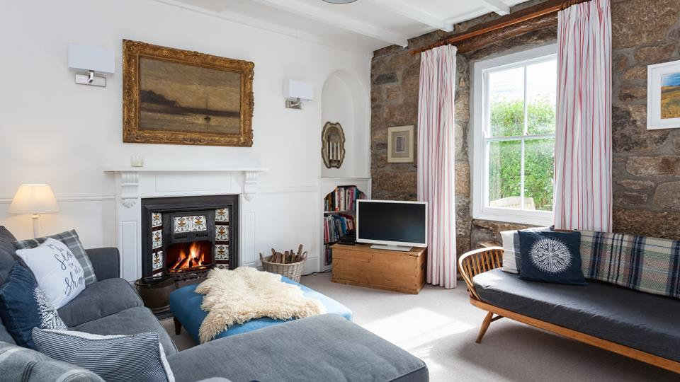 The living room has an open fire to keep you warm and cosy in the colder months.