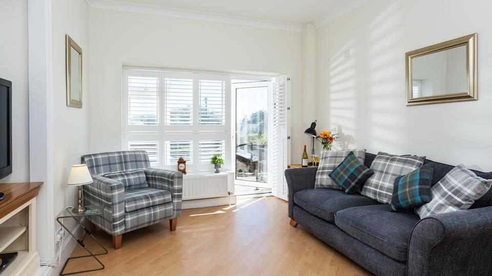 The welcoming open plan living space benefits from sea views.
