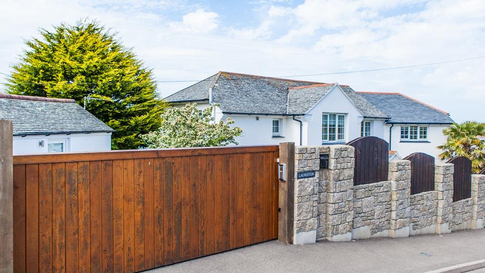Lauriston has private automatic gated parking with a solid wood panel front gate.