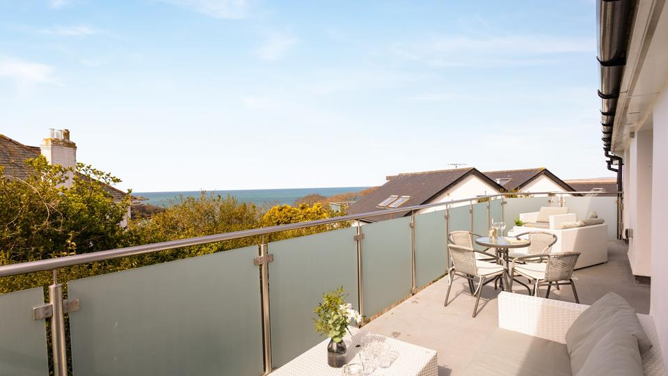 Live the luxurious lifestyle and relax on the private balcony overlooking Carbis Bay.