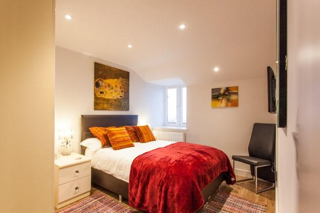 Double bedroom with sea glimpes
