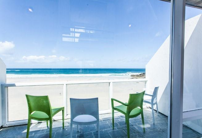 Balcony off of open plan living area with stunning sea views.