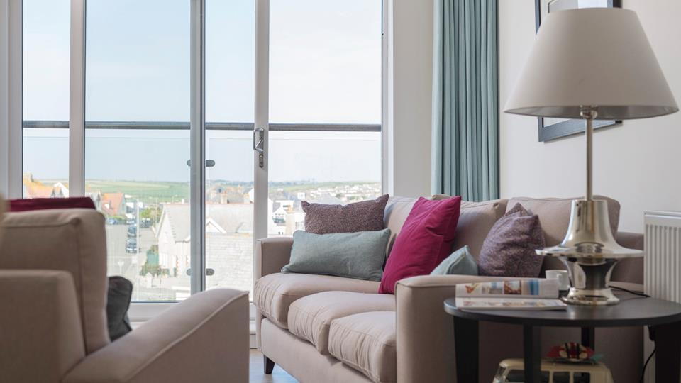 Open the doors to the Juliette balcony and relax on the sofa as you breathe in the fresh Cornish air.