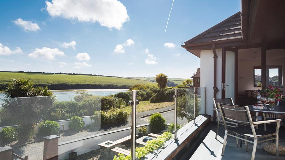 The balcony from the living area and kitchen has stunning views across the Gannel Estuary.