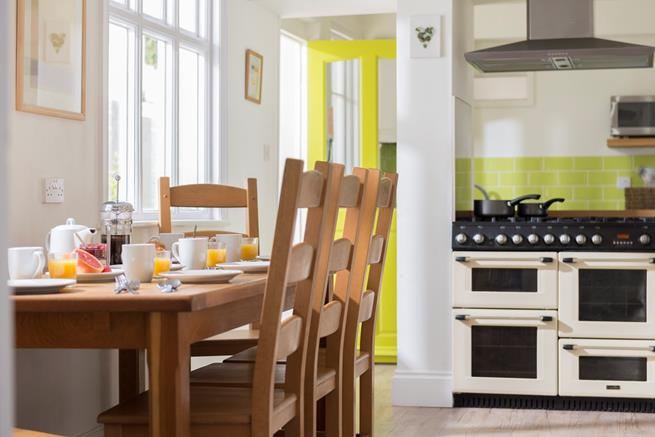 Kitchen/dining room with large range cooker.