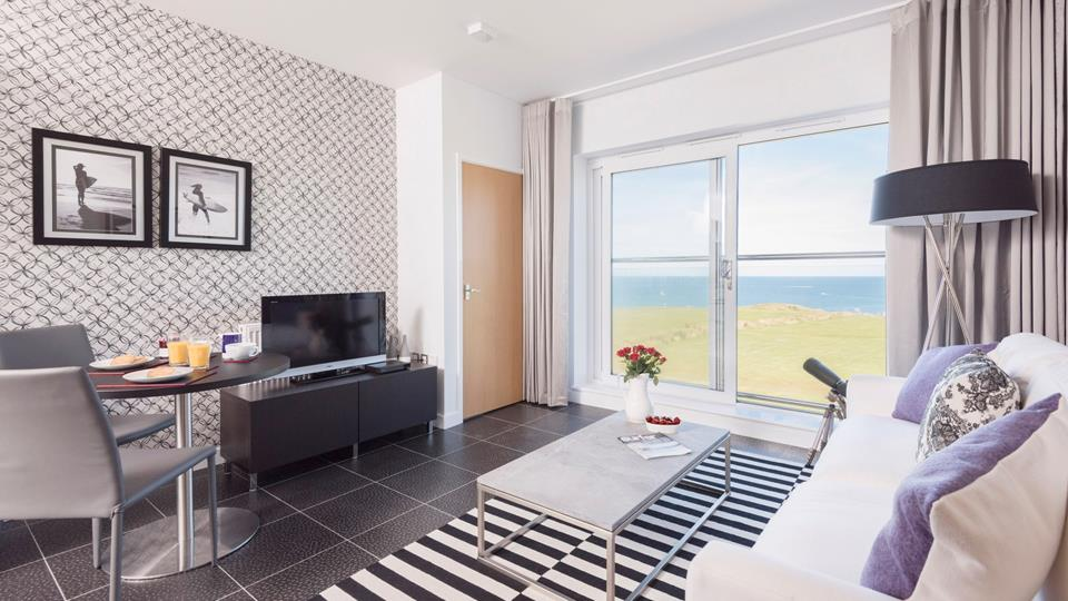 On the third floor, Atlantic Vista is a modern apartment with views from the Juliet balcony across the north coast.