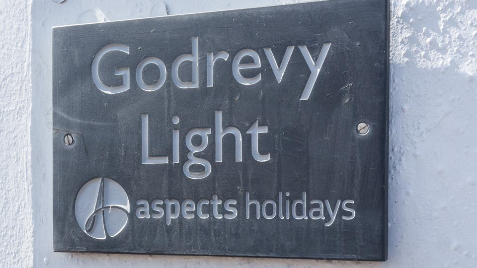 The property has a classic Aspects Holidays slate sign to help make it easy for guests to find their accommodation.