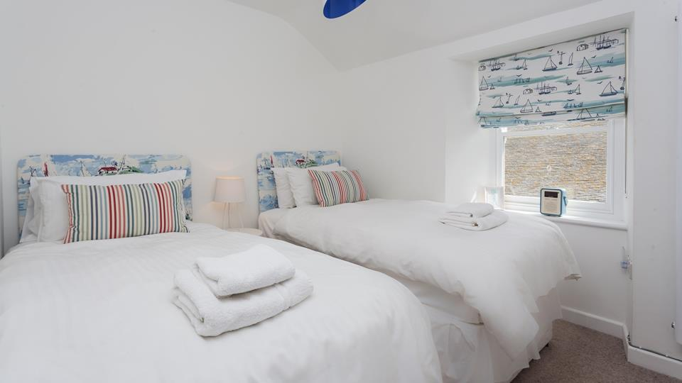 Twin rooms with fun headboards are sure to delight both children and young adults!