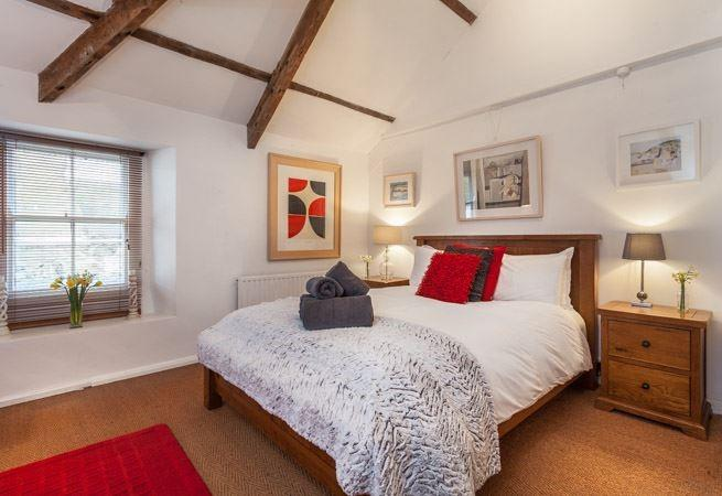 Spacious Master bedroom with feature vaulted ceiling.
