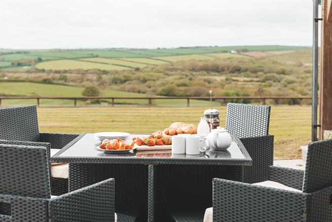 You will be able to relish in the stunning surroundings from the patio at the front of the property.