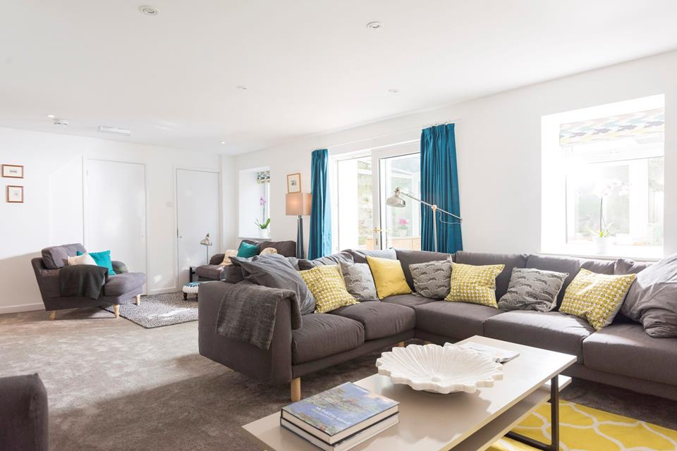 The spacious yet cosy sitting room with multiple seating, a wonderful space to relax together and play a board game or enjoy a film.