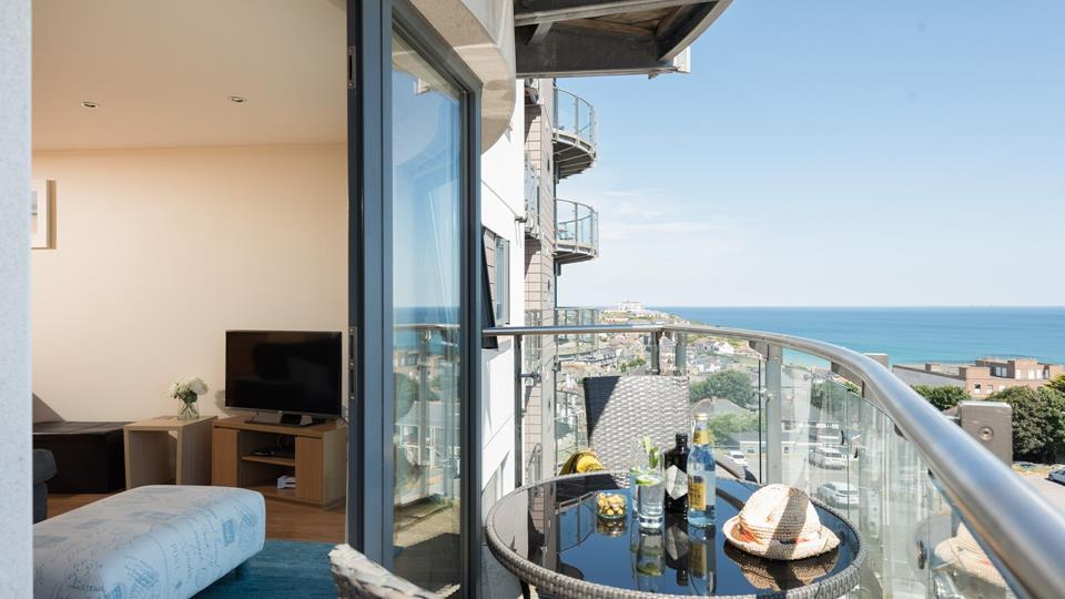 The doors open from the open plan living area onto the front facing balcony.