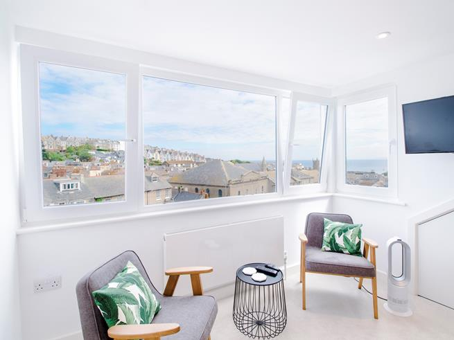 Bedroom 3 has a large dormer window with stunning harbour views.