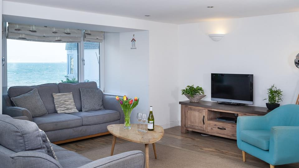 Relax in the comfortable surroundings of the sitting room whilst taking in the amazing views.