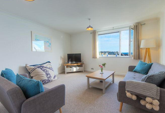 Relaxed sitting room with harbour views.