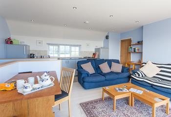 Enjoy a cosy evening together in the open plan living area.
