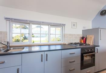 Treat your other half to a romantic meal for two; the well-equipped kitchen has everything you need to cook up a storm.