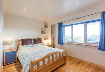 Wake up to dreamy sea views from the comfy double bedroom.