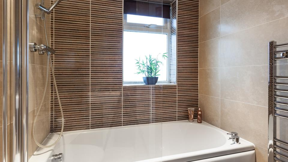 The bath is lovely and spacious, making it the ideal spot to soak your worries away.
