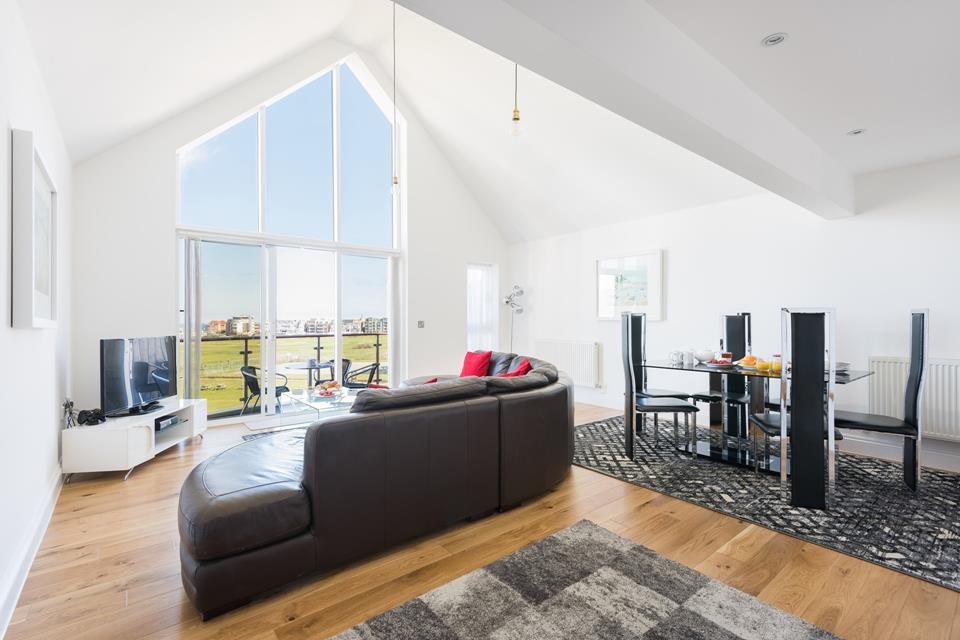 The vaulted ceilings and fresh white walls, provides a light and spacious living area for relaxing of an evening.