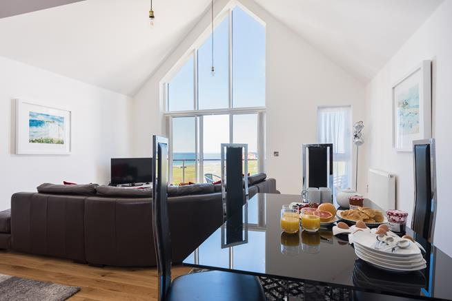Enjoy a meal in with the balcony doors open and listen to the sound of the sea.